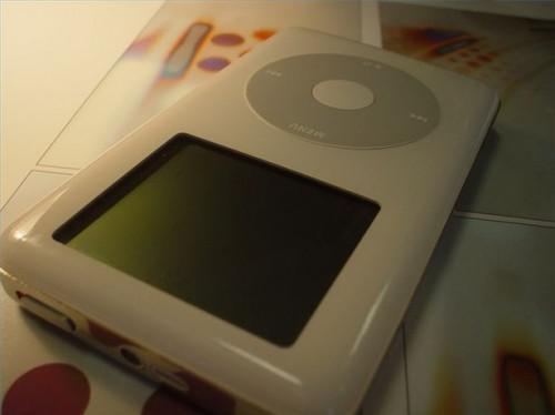 Hvordan kan jeg laste ned musikk til iPod?