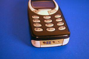 Hvordan å lade en mobiltelefon med en datamaskin