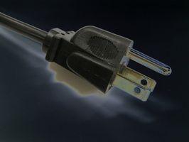 Hva er forskjellen mellom to Pin & tre Pin elektriske plugger?