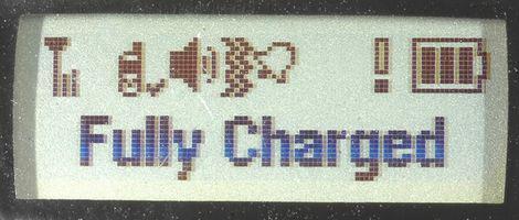 Hvordan å lade en mobiltelefon batteri med en lader