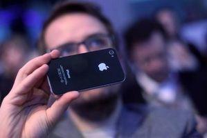 Slik Sync en iPhone etter en gjenoppretting
